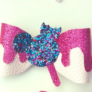 Faux leather bow.